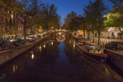 Travel photography Amsterdam at night in reflection